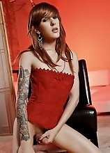 Naughty Ryder posing in sexy red corset
