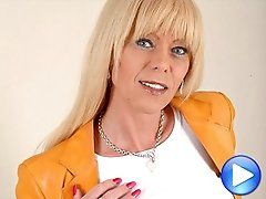 Joanna Jet strips out of blue jeans to play with her rock hard cock