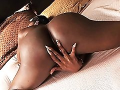 Ebony Natalia fingers on bed