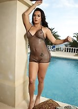 Bianka Passionately Strokes Her Hard Dick by the Pool
